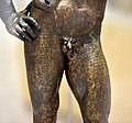 Detail, inscribed, Greek and Parthian script, lower part of a bronze statuette of Hercules, from Seleucia on the Tigris, Iraq. Iraq Museum.jpg