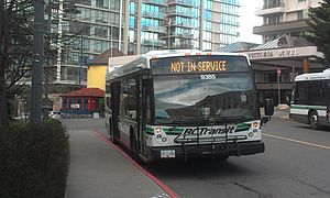 Victoria Regional Transit System - An out of service bus stopped on the side of the road in Downtown Victoria.