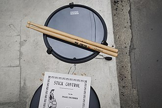 Drumline - A practice pad is an effective way for students to practice outside of school. Stick Control and the Movement Drum Co. 4-in-1 pad.