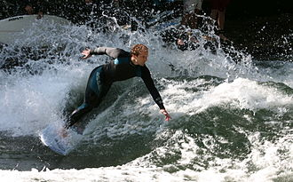 River surfing - Surfer on the Eisbach, Englischer Garten, Munich, Germany.