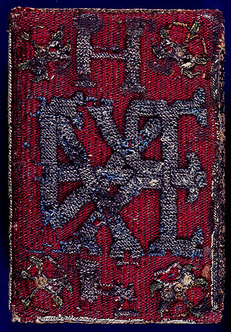 Prayers or Meditations - Embroidered back cover of the trilingual translation by Elizabeth I. Parr's monogram is in the centre.
