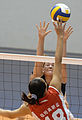 Ens. Ashley Kins tries to block a shot by 2nd Lt. Liu Xiaojing of China during the U.S. women's first volleyball game at the Military World Games in Hyderabad.JPG