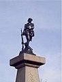 Eugène Bénet (sculpt) 35114 Saint-Benoît-des-Ondes, Poilu marchant l'arme au pied 1923, Inventaire général du patrimoine, b sculpture.jpg