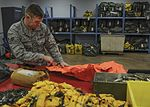 Examining equipment designed to save all lives 160111-F-GE514-043.jpg