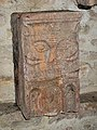Face sculpture in the vestibule of the Saint-Philibert abbey.jpg