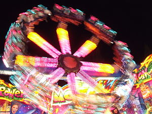 English: Fairground ride lights, at night