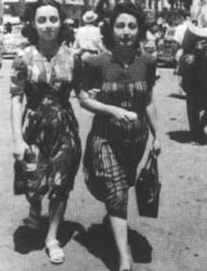Fairuz - Fairuz (Nouhad Haddad) with her mother Liza al-Boustani, crossing Martyrs' Square, Beirut in Beirut, 1945.