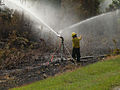 Firefighter Monitors Water Flow from Irrigation Equipment (5755189128).jpg