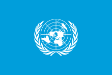 The flag of the United Nations: A white map of the world encircled in a white laurel wreath on a light blue field