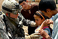 Flickr - The U.S. Army - Highlander Combat Medics and Balad Airmen Deliver Medical Aid to Balad Iraqis.jpg