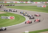 Cars wind through the infield section at the start of the 2003 USGP