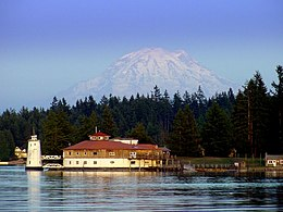 A building on the north shore of Tanglewood Island with Mount Rainier in the distance behind it.