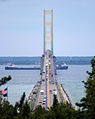 Freighter passing under Mackinac Bridge.jpg