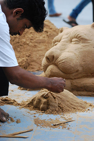 Sand festival - Sand sculptor at work at the Goa Sand Art Festival