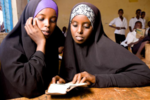 Girls reading (8330296421).png