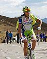 Giro d'Italia 2012, giau 171 capecchi worstelend met zijn jasje (17786724895).jpg