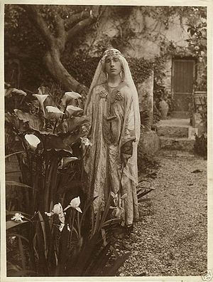 Wilhelm von Gloeden - Boy disguised as an odalisque in Gloeden's garden in Taormina. The reverse bears the stamp of Gloeden's heir, Pancrazio Buciunì, and the date: May 16, 1914