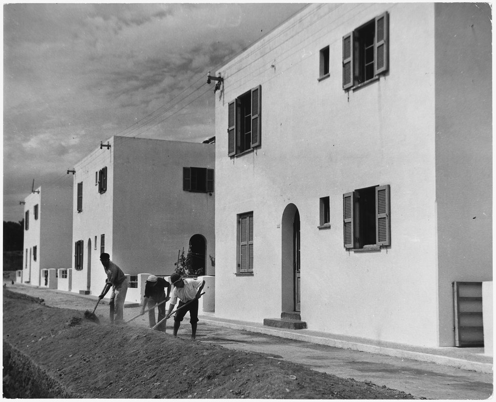 Greece. Workmen grade the street in front of new housing constructed with the help of Marshall Plan funds in Greece - NARA - 541700