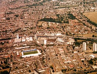 Griffin Park - Griffin Park pictured from the Heathrow flightpath in 1995, with a KLM advertisement visible on the roof of the New Road stand.