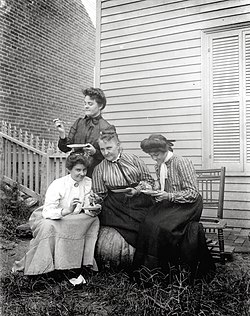 Group of four women eating outdoors
