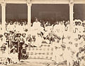 H.H.Shahu Chhatrapati Maharaj sitting amongst crowds watching a wrestling match.jpg