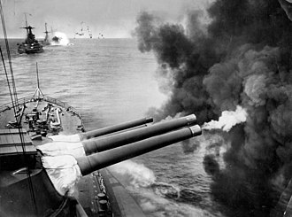 BL 15-inch Mk I naval gun - BL 15-inch Mk I naval guns firing, interwar view of a Queen Elizabeth class battleship - the right-hand gun in each turret has just fired and the degree of recoil is evident