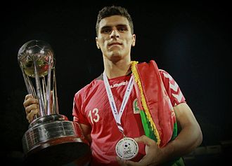 Afghanistan national football team - Hamidullah Karimi with the SAFF Championship trophy after their win against India