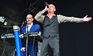 Heaven 17 performing live in 2014 Left to right: Martyn Ware (keyboards), Glenn Gregory (vocals)
