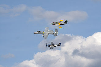 EAA AirVenture Oshkosh - F-86 Sabre (top), A-10 Thunderbolt II (mid), and P-51D Mustang (bottom) performing at Oshkosh in 2009
