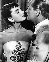 A still of Hepburn on the left opposite William Holden on the right in the film Sabrina.