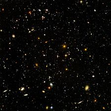 The deepest visible-light image of the cosmos, the Hubble Ultra Deep Field.