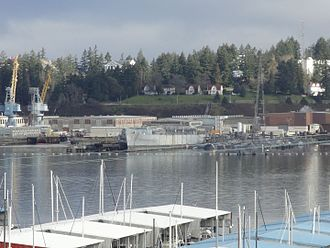 USS Long Beach (CGN-9) - Hull of Long Beach sitting in Puget Sound Naval Shipyard awaiting recycling in March 2011. Picture taken from top of hill in Port Orchard looking north across the water to the shipyard.
