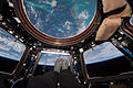 ISS-46 The Bahamas and Scott Kelly's feet seen in the Cupola.jpg