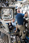 ISS-55 Drew Feustel and Scott Tingle at work inside the Destiny lab.jpg