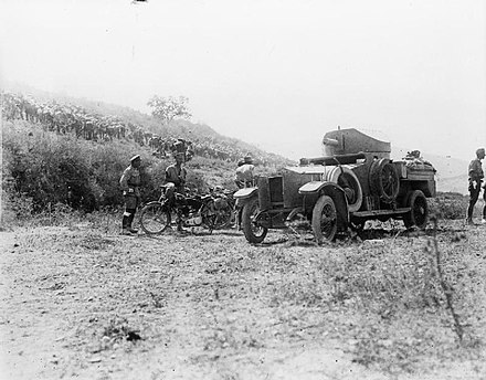 British armoured car and motorcycle at the Battle of Megiddo (1918). IWM-Q-12329-armoured-car-Megiddo-1918.jpg