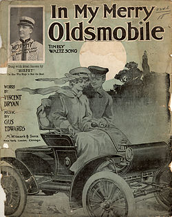 In My Merry Oldsmobile songbook featuring an Oldsmobile Curved Dash automobile and period driving clothing