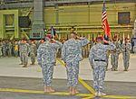 Incoming commander Army Col. Matthew W. McFarlane (left), outgoing commander Col. Morris T. Goins (center), and the Commanding .General of U.S. Army, Alaska, Maj. Gen. Michael X. Garrett (right), salute the U.S 121205-A-ZX807-001.jpg