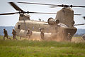 Indian soldiers and U.S. Army paratroopers exit a CH47 Chinook helicopter during a field training exercise in 2013.jpg