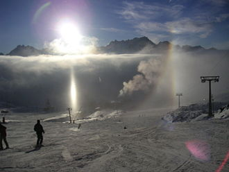 Diamond dust - Subhorizon halos in Ischgl: subsun, subparhelion and partial 22° halo, with the glint of ice crystals around the subsun.