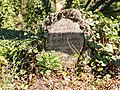 Ivy covered tombstone (24897165015).jpg