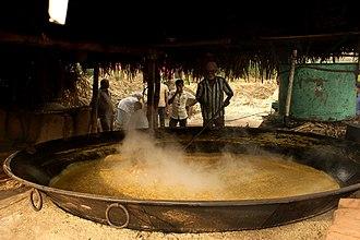 Muscovado - Boiling sugarcane juice to make molasses