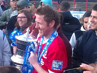 Welling United F.C. - Former player manager Jamie Day with the Conference South trophy after winning the title in 2013