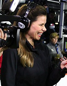 Dressed in a black shirt, wearing a Fox Sports headset