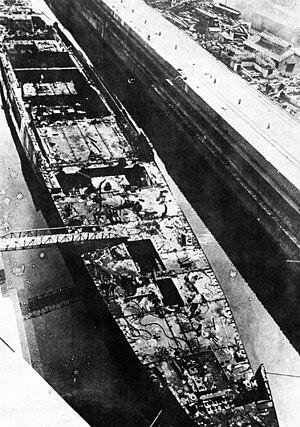 Japanese cruiser Ibuki (1943) - Ibuki being scrapped, March 14, 1947.