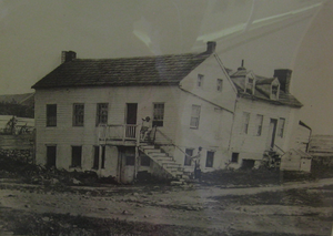 John L. Burns - John Burns' house shortly after the battle. John Burns is seated at top of stairs.