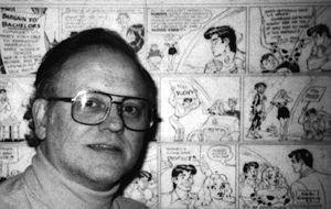 John Workman - Workman in front of a Li'l Abner page in his studio
