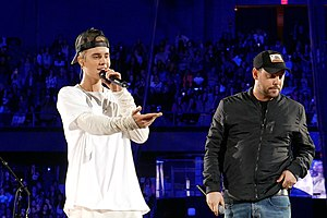 Purpose (Justin Bieber album) - Bieber and Scooter Braun (right) during a show to promote Purpose in 2015.