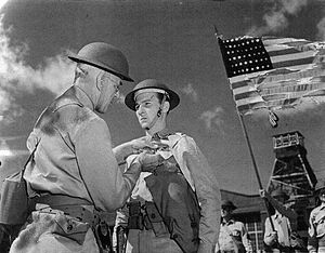 Kenneth M. Taylor - Taylor receiving the Distinguished Service Cross on January 8, 1942 for his efforts