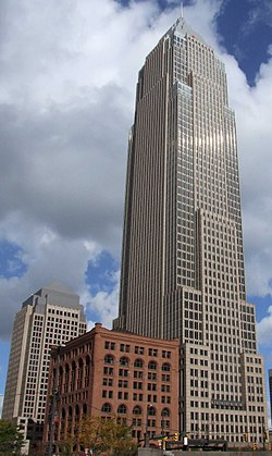 Cleveland skyscrapers of two eras meet on Public Square: Cesar Pelli's 20th Century Key Tower (1992) and John Wellborn Root's 19th Century Society for Savings Building (1890).