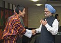 King of Bhutan Jigme Khesar Namgyel Wangchuck greeting the Prime Minister, Dr. Manmohan Singh on the successful completion of the XIX Commonwealth Games 2010 Delhi.jpg